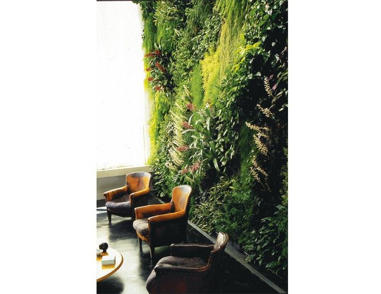 loft mur vegetal fauteuils en cuir